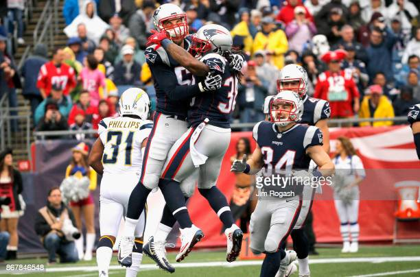 Brandon Bolden of the New England Patriots reacts with Trevor Reilly after a tackle during the first quarter of a game against the Los Angeles...