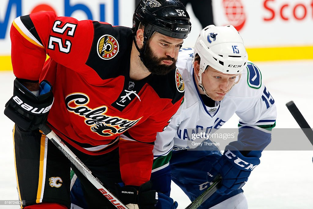 Brandon Bollig #52 of the Calgary Flames skates against Derek Dorsett #15 of the Vancouver Canucks during an NHL game on April 7, 2016 at the Scotiabank Saddledome in Calgary, Alberta, Canada.