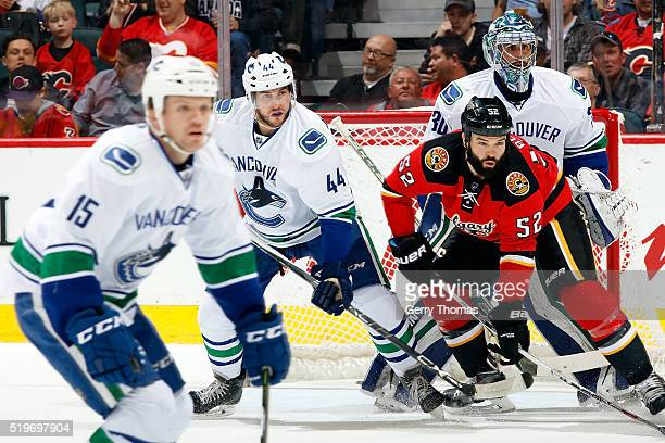 Brandon Bollig of the Calgary Flames skates against Matt Bartkowski of the Vancouver Canucks during an NHL game on April 7, 2016 at the Scotiabank...