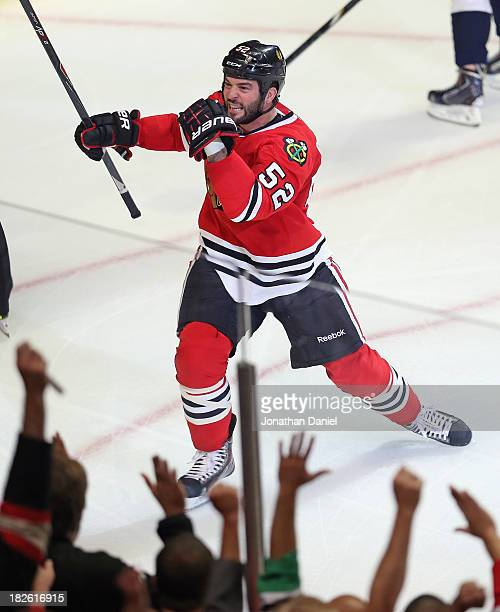 Brandon Bollig of the Chicago Blackhawks celebrates a first period goal against the Washington Capitals at the United Center on October 1 2013 in...