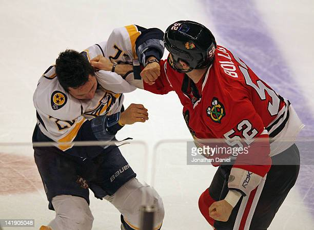 Brandon Bollig of the Chicago Blackhawks fights with Jordin Tootoo of the Nashville Predators at the United Center on March 25 2012 in Chicago...