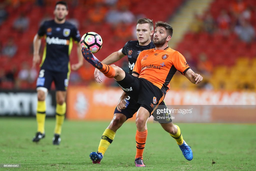 Brandon Borello of the Roar and Scott Galloway of the Mariners compete for the ball during the round 25 A-League match between the Brisbane Roar and the Central Coast Mariners at Suncorp Stadium on April 2, 2017 in Brisbane, Australia.