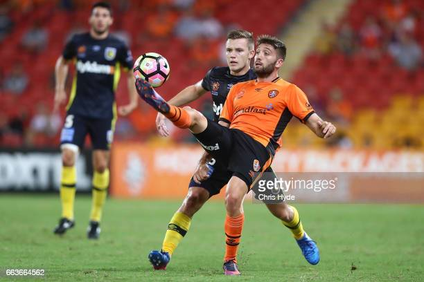 Brandon Borello of the Roar and Scott Galloway of the Mariners compete for the ball during the round 25 ALeague match between the Brisbane Roar and...