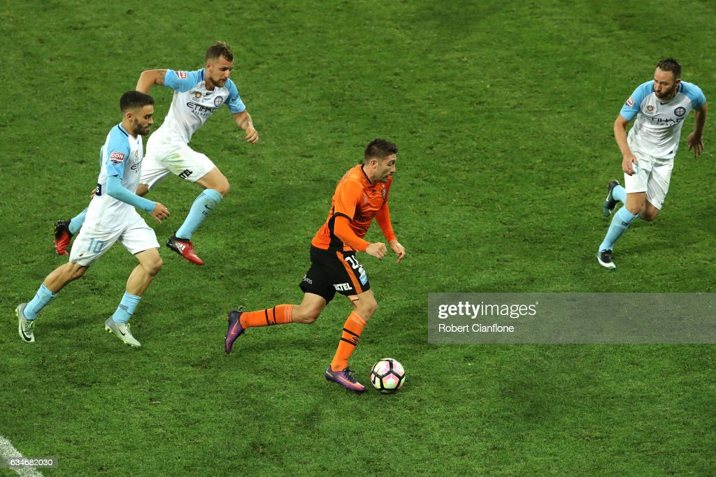 Brandon Borello of the Roar is chased by his opponents during the round 19 A-League match between Melbourne City FC and the Brisbane Roar at AAMI Park on February 11, 2017 in Melbourne, Australia.
