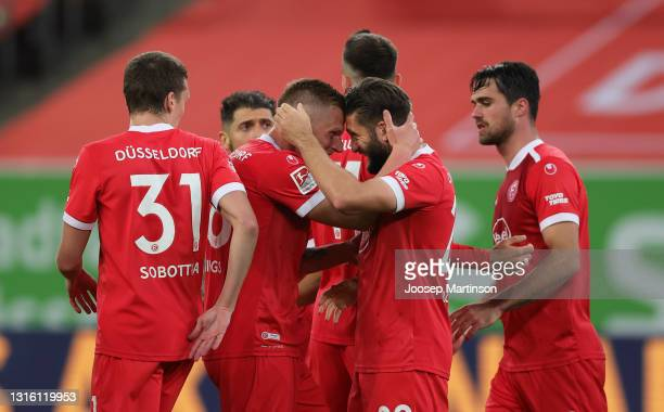 Brandon Borrello of Fortuna Dusseldorf celebrates with team mates after scoring their side's second goal during the Second Bundesliga match between...
