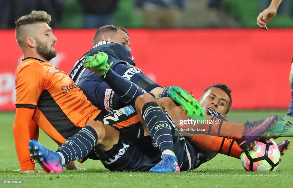Brandon Borrello of the Roar and Daniel Georgievski and Leigh Broxham of the Victory compete for the ball during the A-League Semi Final match between Melbourne Victory and the Brisbane Roar at AAMI Park on April 30, 2017 in Melbourne, Australia.