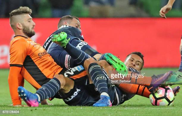 Brandon Borrello of the Roar and Daniel Georgievski and Leigh Broxham of the Victory compete for the ball during the ALeague Semi Final match between...