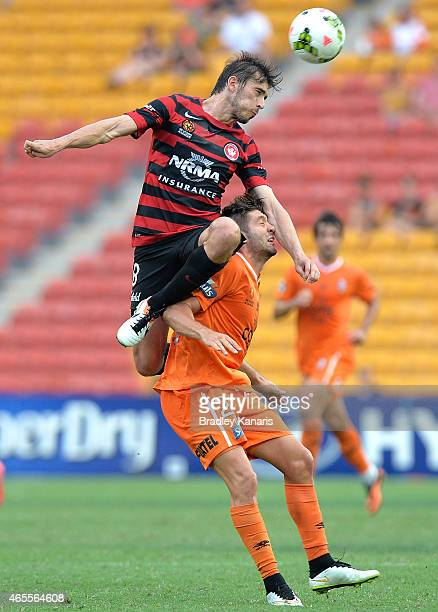 Brandon Borrello of the Roar and Mateo Poljak of the Western Sydney Wanderers challenge for the ball during the round 20 ALeague match between the...