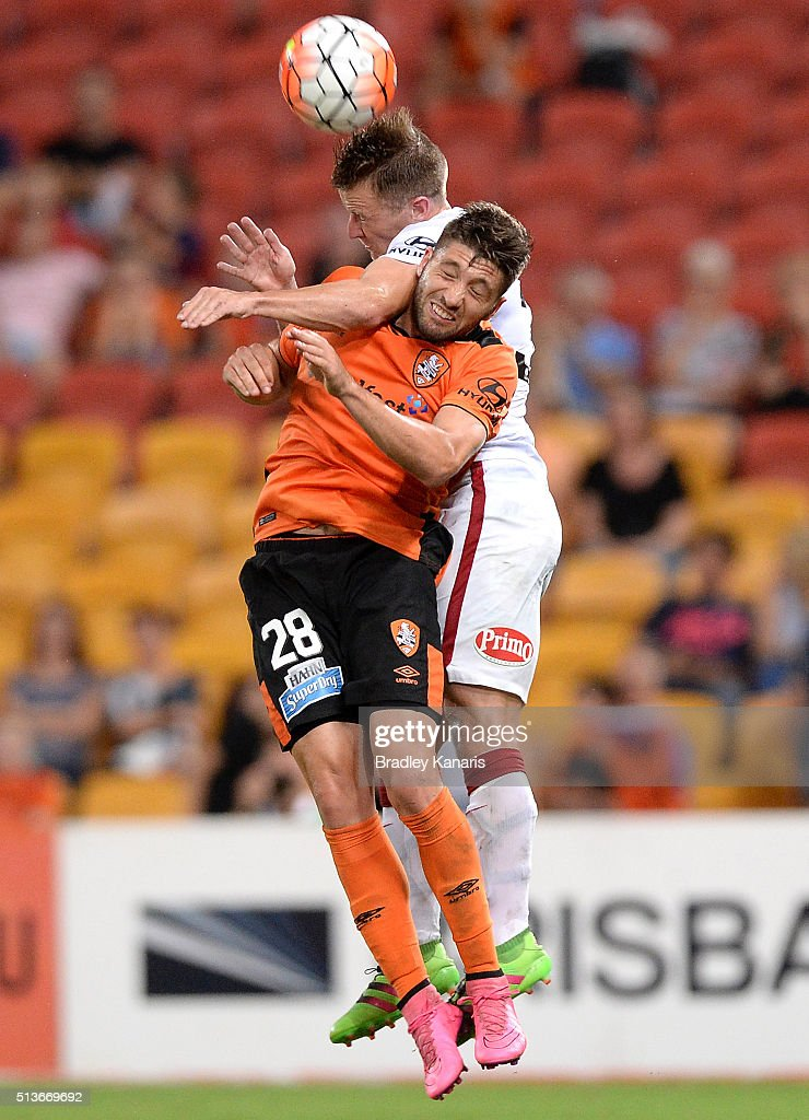 Brandon Borrello of the Roar and Scott Jamieson of the Wanderers challenge for the ball during the round 22 A-League match between the Brisbane Roar and the Western Sydney Wanderers at Suncorp Stadium on March 4, 2016 in Brisbane, Australia.