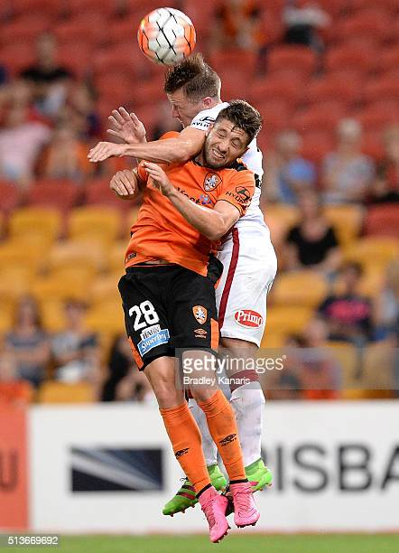 Brandon Borrello of the Roar and Scott Jamieson of the Wanderers challenge for the ball during the round 22 ALeague match between the Brisbane Roar...