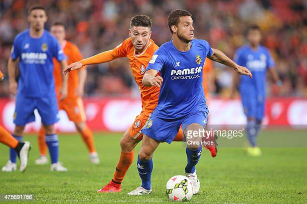 Brandon Borrello of the Roar and Tano Bonnin of Villarreal CF compete for the ball during the international friendly match between the Brisbane Roar...