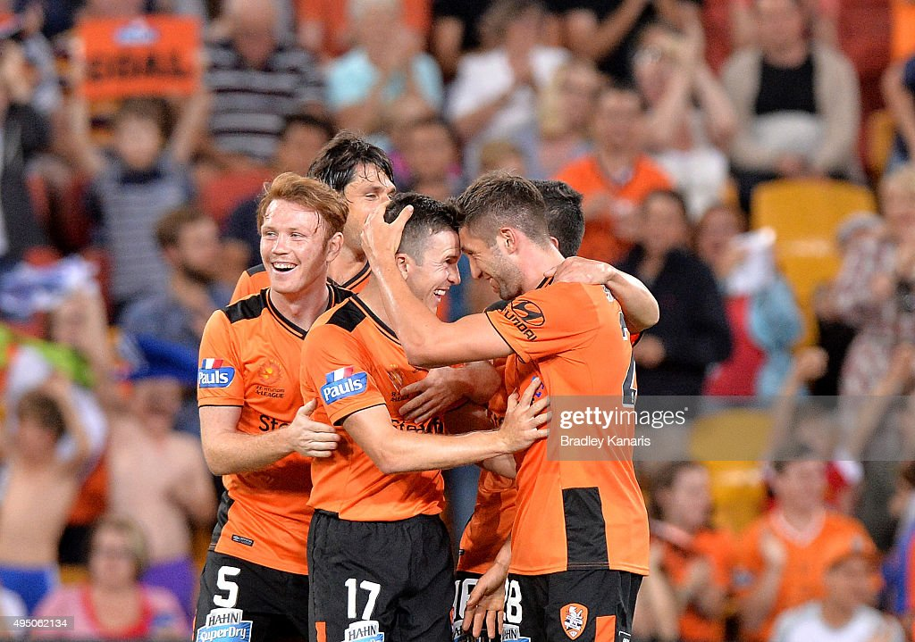 Brandon Borrello of the Roar celebrates after scoring a goal with team mate Matt McKay during the round four A-League match between Brisbane Roar and Adelaide United at Suncorp Stadium on October 31, 2015 in Brisbane, Australia.