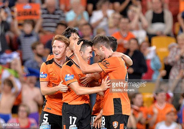 Brandon Borrello of the Roar celebrates after scoring a goal with team mate Matt McKay during the round four ALeague match between Brisbane Roar and...