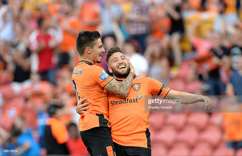 Brandon Borrello of the Roar celebrates scoring a goal with team mate Jamie Maclaren during the round two A-League match between the Brisbane Roar and Central Coast Mariners at Suncorp Stadium on October 18, 2015 in Brisbane, Australia.