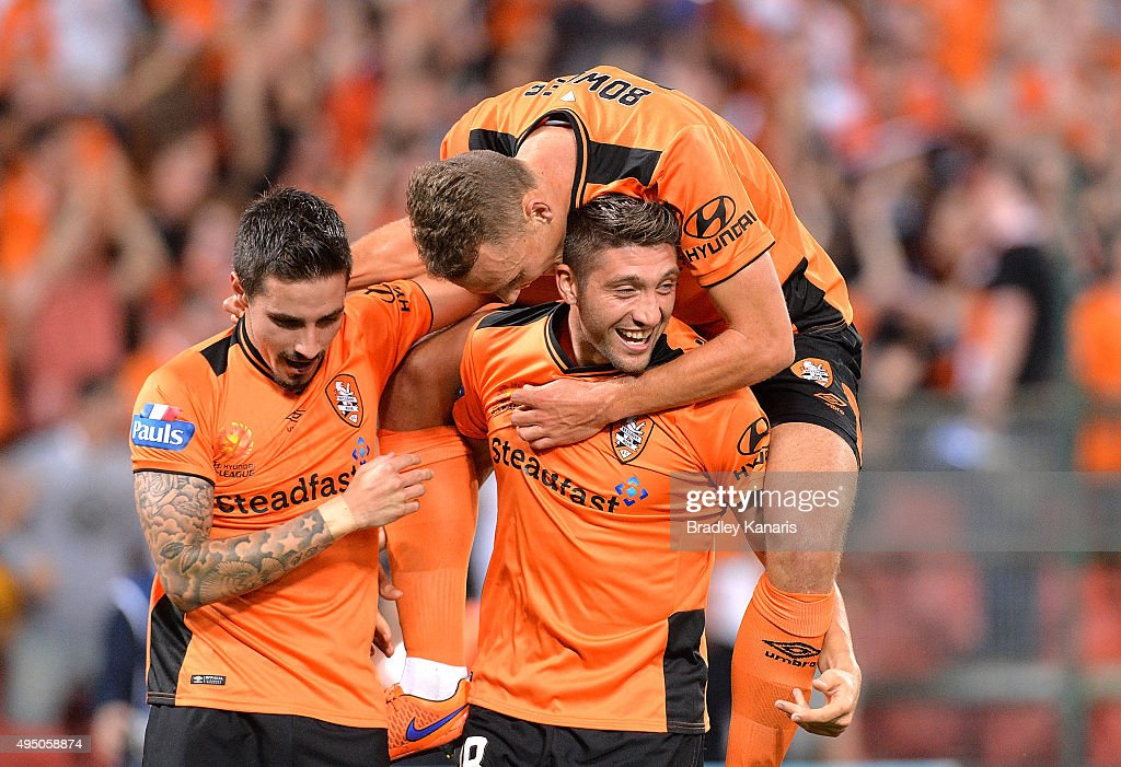 Brandon Borrello of the Roar celebrates scoring a goal with team mates during the round four A-League match between Brisbane Roar and Adelaide United at Suncorp Stadium on October 31, 2015 in Brisbane, Australia.