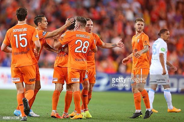 Brandon Borrello of the Roar celebrates with team mates after kicking a goal during the round five ALeague match between the Brisbane Roar and...