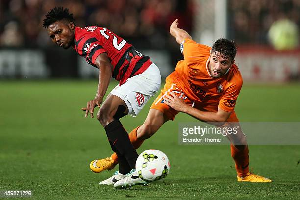 Brandon Borrello of the Roar competes with Seyi Adeleke of the Wanderers during the round four ALeague match between the Western Sydney Wanderers and...