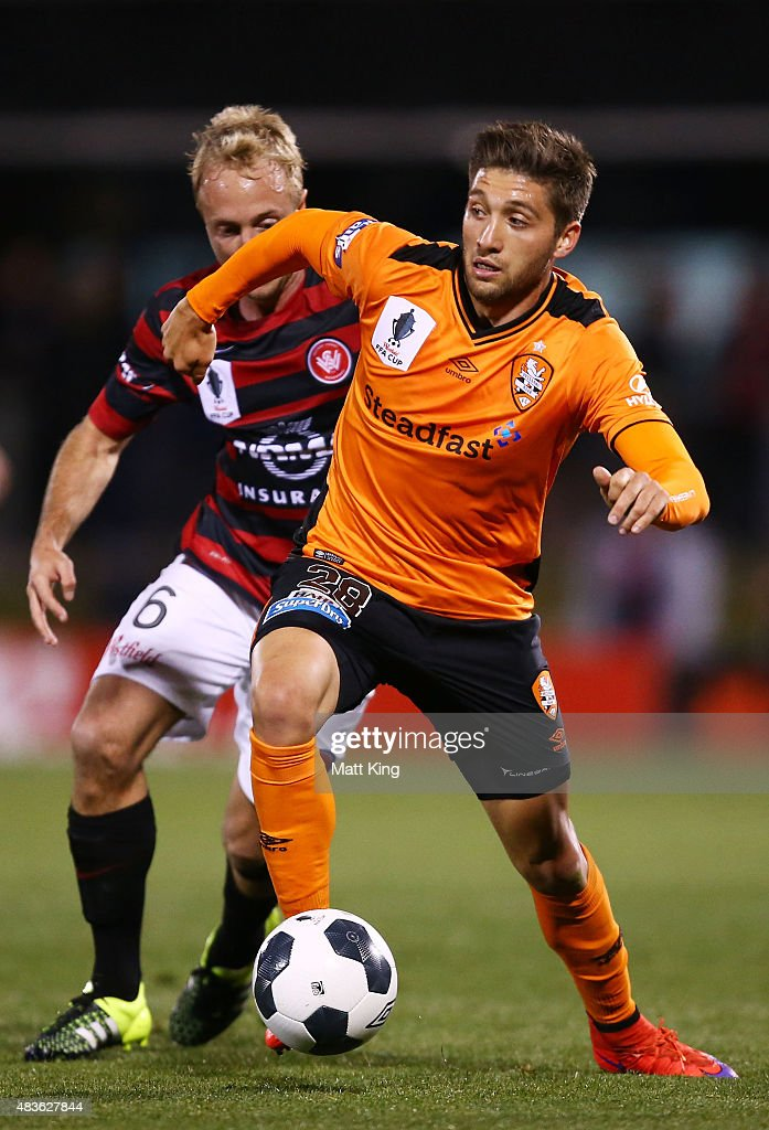 Brandon Borrello of the Roar is challenged by Mitch Nichols of the Wanderers during the FFA Cup match between Western Sydney Wanderers and Brisbane Roar at Pepper Stadium on August 11, 2015 in Sydney, Australia.