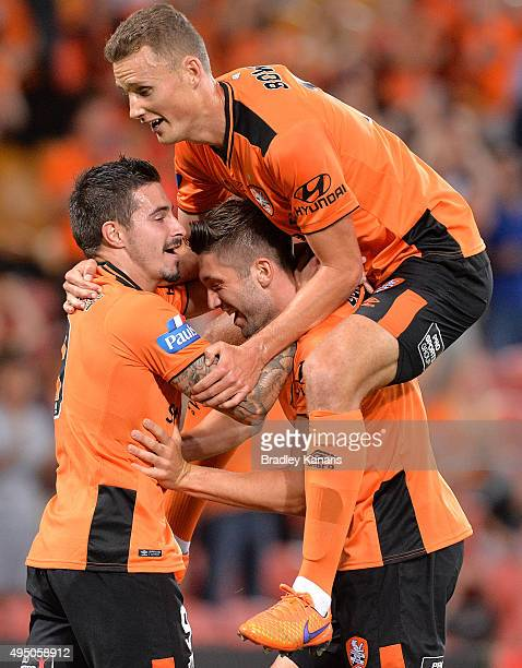 Brandon Borrello of the Roar is congratulated by team mates after scoring a goal during the round four ALeague match between Brisbane Roar and...