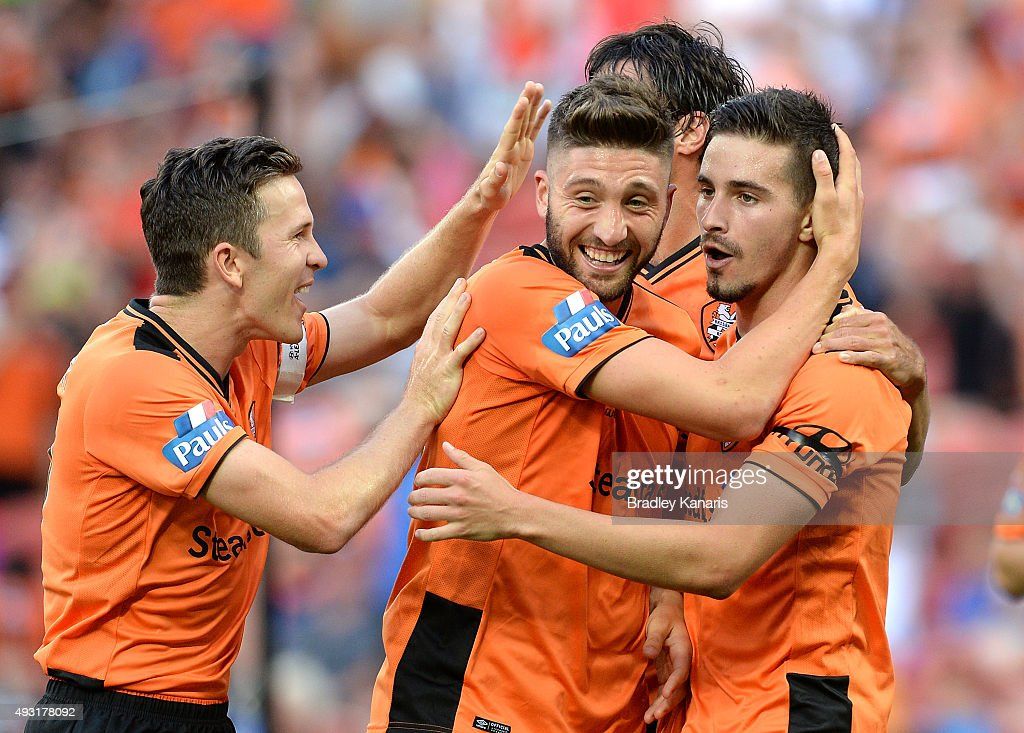 Brandon Borrello of the Roar is congratulated by team mates Matt McKay (L) and Jamie Maclaren (R) after scoring a goal during the round two A-League match between the Brisbane Roar and Central Coast Mariners at Suncorp Stadium on October 18, 2015 in Brisbane, Australia.