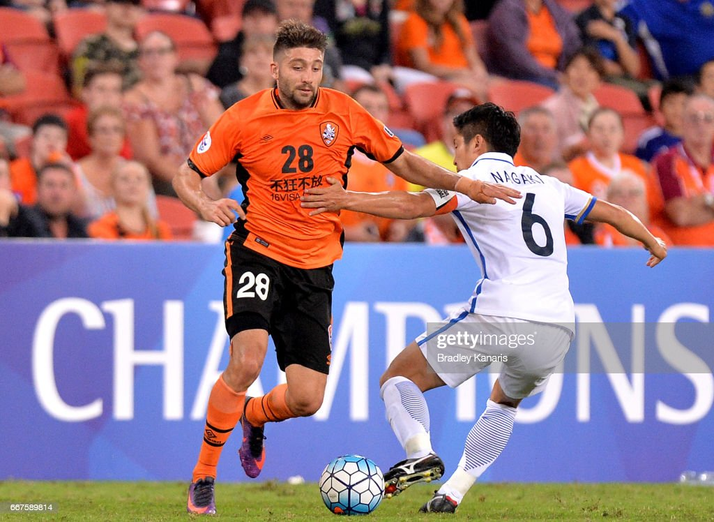Brandon Borrello of the Roar takes on the defence of Ryota Nagaki of the Antlers during the AFC Asian Champions League Group Stage match between the Brisbane Roar and Kashima Antlers at Suncorp Stadium on April 12, 2017 in Brisbane, Australia.