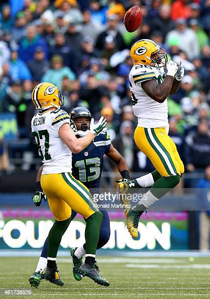 Brandon Bostick of the Green Bay Packers bobbles an onsides kick as Chris Matthews of the Seattle Seahawks and Jordy Nelson of the Green Bay Packers...