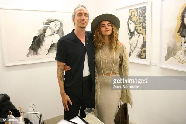 Brandon Boyd and artist Alea Remains pose at OptiMystic A Brandon Boyd Pop Up Gallery Featuring He Tasya Van Ree Natalie Bergman Diana Garcia And DJ...