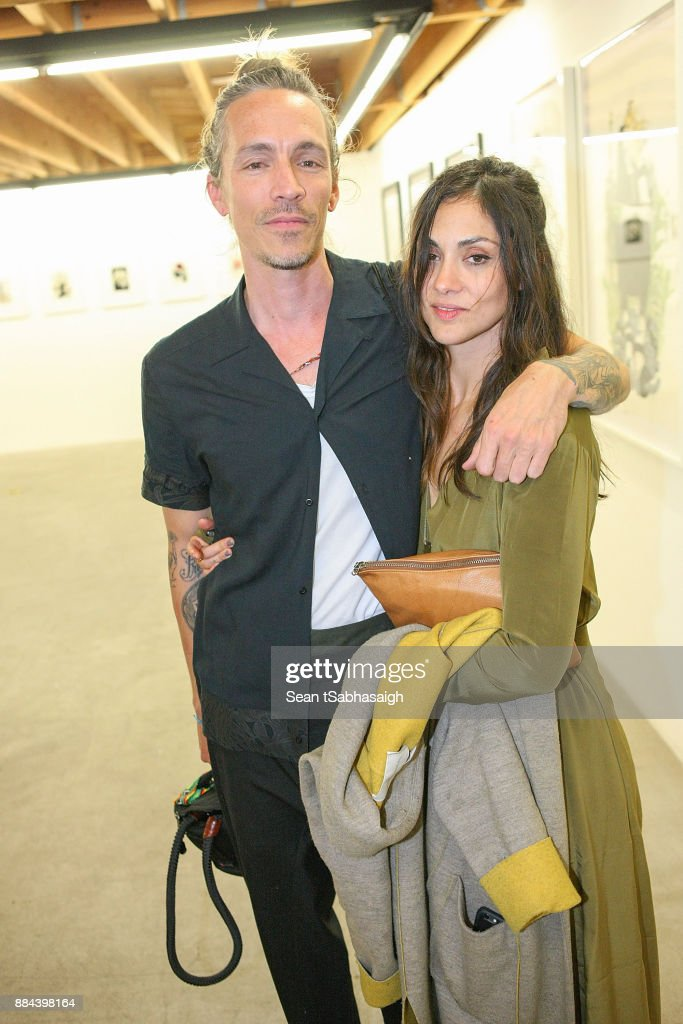 Brandon Boyd and artist Diana Garcia pose at OptiMystic: A Brandon Boyd Pop Up Gallery Featuring He, Tasya Van Ree, Natalie Bergman, Diana Garcia And DJ Set By Brent Bolthouse at 101/Exhibit Gallery on December 1, 2017 in West Hollywood, California.
