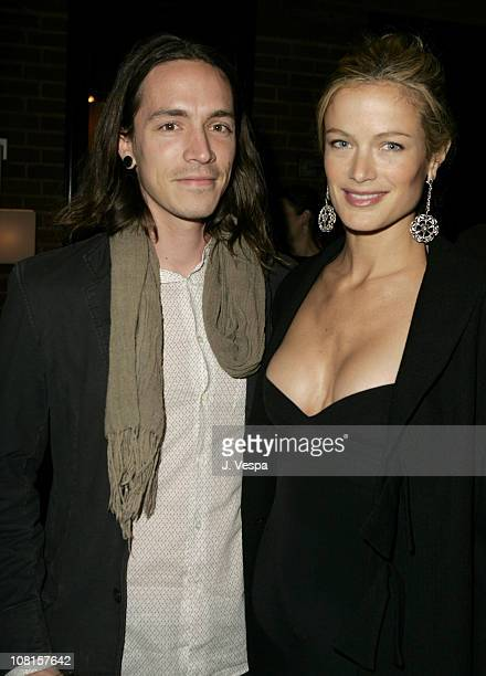 Brandon Boyd and Carolyn Murphy during GQ Magazine Celebrates its 2004 Men of the Year Dinner at Lucques Restaurant in Los Angeles California United...