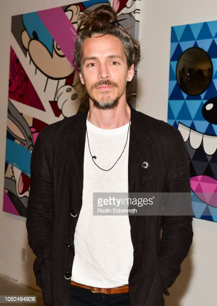 Brandon Boyd poses for portrait at Greg Mike's Los Angeles solo debut VIP preview for 'Inside Voice' on October 18 2018 in West Hollywood California