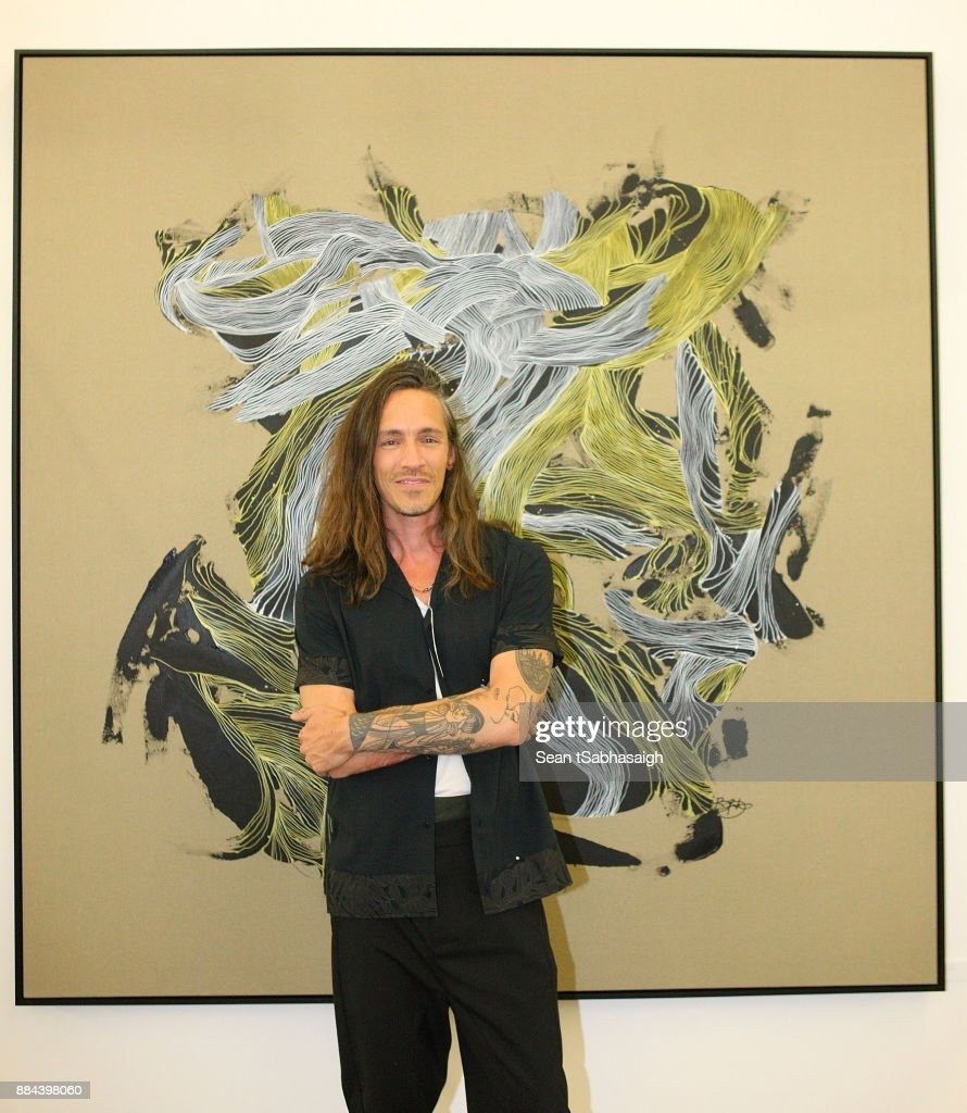 Brandon Boyd poses in front of his artwork at OptiMystic: A Brandon Boyd Pop Up Gallery Featuring He, Tasya Van Ree, Natalie Bergman, Diana Garcia And DJ Set By Brent Bolthouse at 101/Exhibit Gallery on December 1, 2017 in West Hollywood, California.