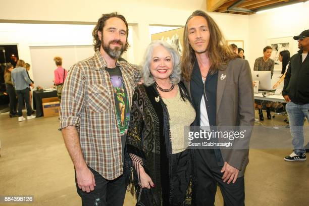 Brandon Boyd poses with his mother Dolly Wiseman and brother Jason Boyd at OptiMystic A Brandon Boyd Pop Up Gallery Featuring He Tasya Van Ree...