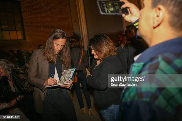 Brandon Boyd signs autographs at OptiMystic A Brandon Boyd Pop Up Gallery Featuring He Tasya Van Ree Natalie Bergman Diana Garcia And DJ Set By Brent...