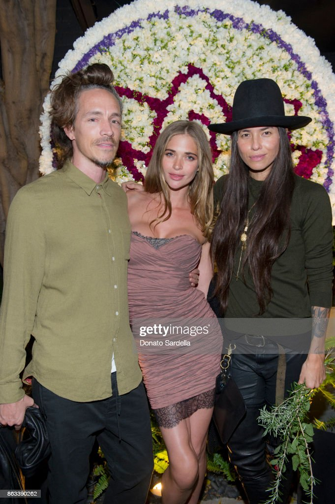 Brandon Boyd (left), Tasya van Ree (right) and guest at Living Beauty 'The Gift' Photo Exhibit at The Buterbaugh Gallery on October 19, 2017 in Los Angeles, California.