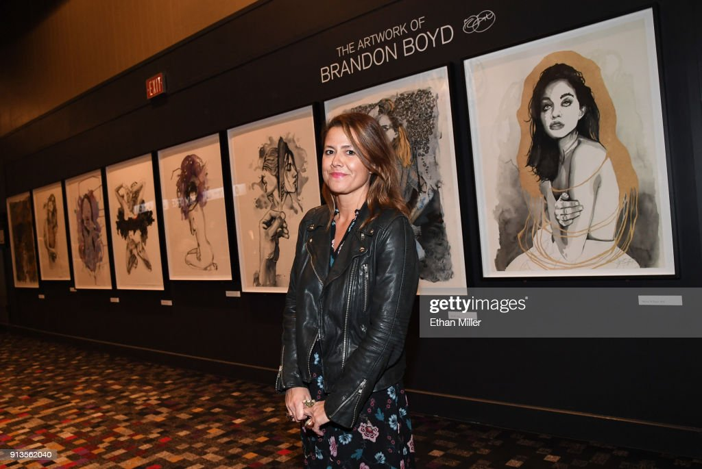 Brandon Boyd's art manager Jen DiSisto poses in front of a display of fine art giclee prints by the Incubus singer outside The Joint inside the Hard Rock Hotel & Casino ahead of the first night of the band's four-show limited engagement on February 2, 2018 in Las Vegas, Nevada.