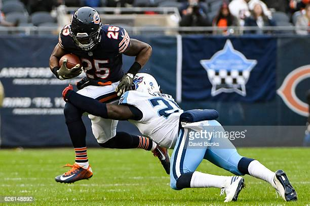 Brandon Boykin of the Chicago Bears carries the football against Da'Norris Searcy of the Tennessee Titans in the third quarter at Soldier Field on...