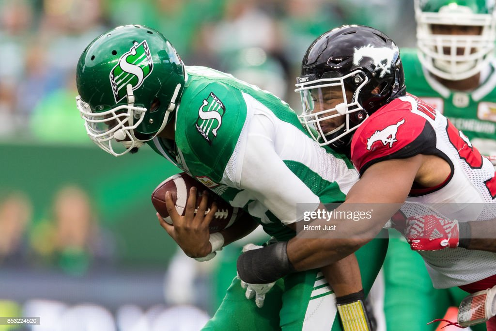 Brandon Bridge #16 of the Saskatchewan Roughriders is tackled from behind by James Vaughters #98 of the Calgary Stampeders in the game between the Calgary Stampeders and Saskatchewan Roughriders at Mosaic Stadium on September 24, 2017 in Regina, Canada.