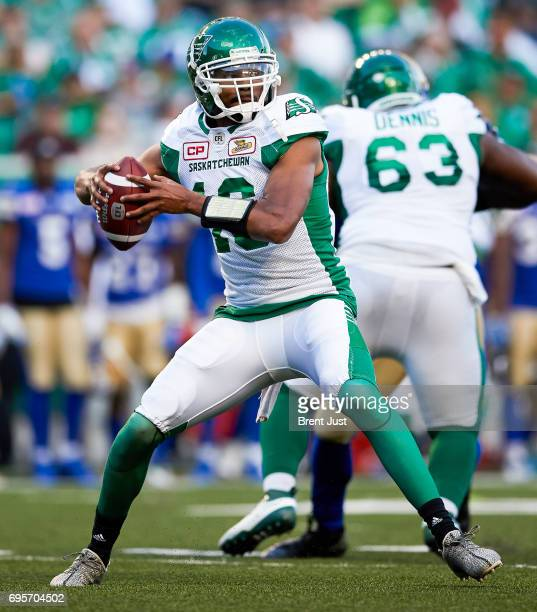 Brandon Bridge of the Saskatchewan Roughriders looks to throw in the first half of the preseason game between the Winnipeg Blue Bombers and...