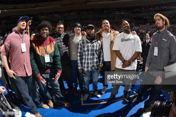 Brandon Brooks and Kenjon Barner of the Philadelpha Eagles pose with fans during the Philadelphia 76ers v Washington Wizards game on February 6 2018...
