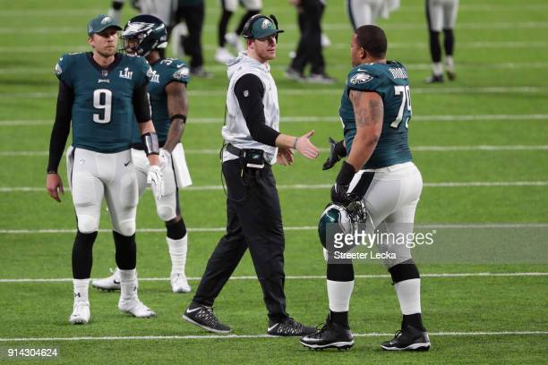 Brandon Brooks is congratulated by his teammate Carson Wentz of the Philadelphia Eagles after their first quarter field goal against the New England...