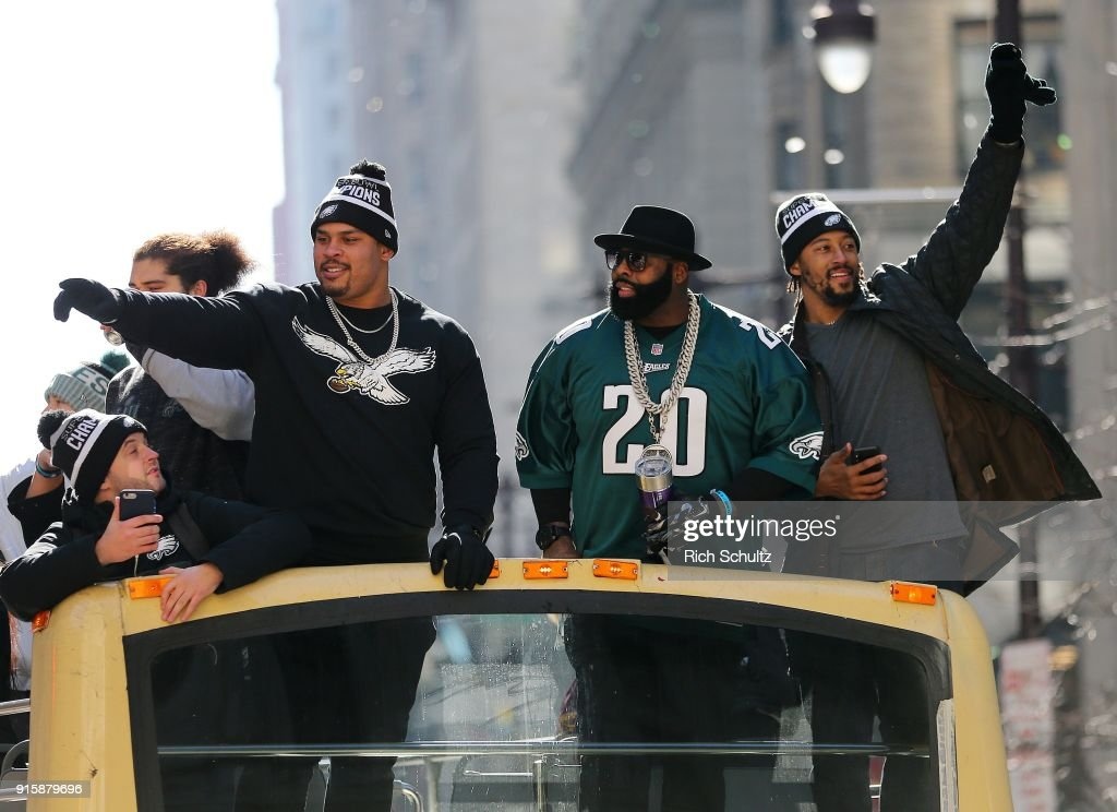 Brandon Brooks #79, Jason Peters #71, and Will Beatty #66 celebrate during the Super Bowl LII parade on February 8, 2018 in Philadelphia, Pennsylvania.