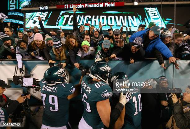 Brandon Brooks Lane Johnson and Mack Hollins of the Philadelphia Eagles celebrate with the fans after a fourth quarter touchdown against the...