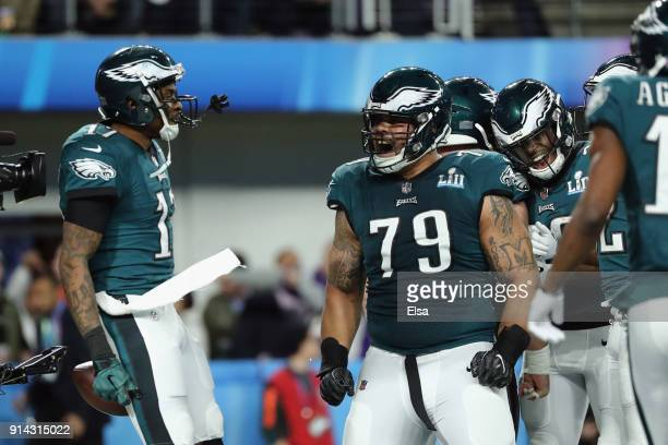 Brandon Brooks of the Philadelphia Eagles and teammate Alshon Jeffery celebrates a 34yard touchdown pass in the first quarter of Super Bowl LII at US...