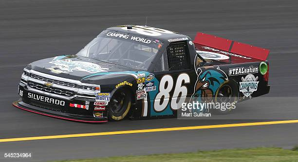 Brandon Brown driver of the Coastal Carolina University Chevrolet practices for the NASCAR Camping World Truck Series Buckle Up In Your Truck 225 at...