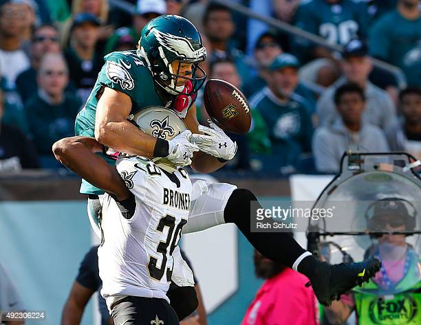 Brandon Browner of the New Orleans Saints breaks up a pass to Riley Cooper of the Philadelphia Eagles in the third quarter during a football game at...