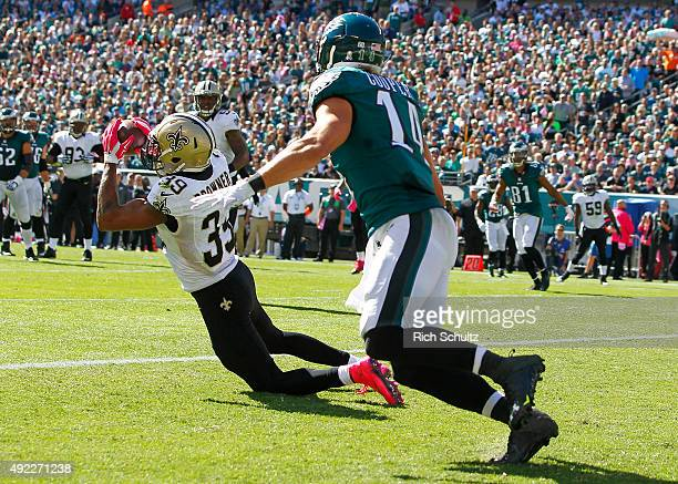 Brandon Browner of the New Orleans Saints makes an interception in the end zone on a pass intended for Riley Cooper of the Philadelphia Eagles in the...