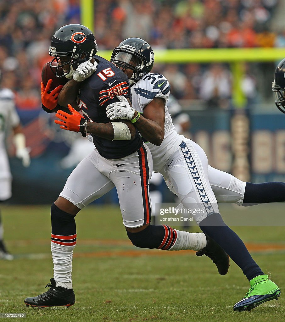 Brandon Browner #39 of the Seattle Seahawks knocks the ball away from Brandon Marshall #15 of the Chicago Bears at Soldier Field on December 2, 2012 in Chicago, Illinois.