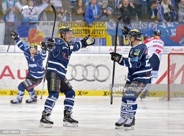 Brandon Buck and Timo Pielmeier of ERC Ingolstadt celebrate after scoring the 1:0 during the game between ERC Ingolstadt and Eisbaeren Berlin on...