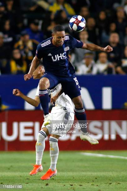 Brandon Bye of New England Revolution and Uriel Antuna of Los Angeles Galaxy compete for a header during the first half of a game at Dignity Health...