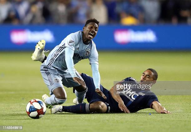Brandon Bye of New England Revolution takes down Gerso of Sporting Kansas City resulting in a red card ejection for Bye during the game at Children's...